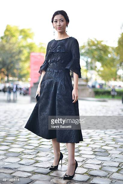 Wen Ya poses wearing a Shiatzy Chen dress before the Shiatzy Chen show at the Grand Palais during Paris Fashion Week SS16 on October 6 2015 in Paris...