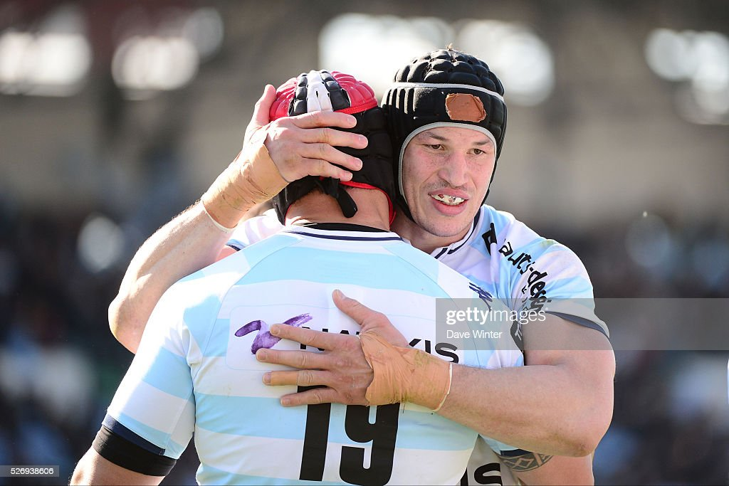 Wenceslas Lauret and Chris Masoe of Racing 92 celebrate winning the French Top 14 rugby union match between Racing 92 v Clermont at Stade Yves Du Manoir on May 1, 2016 in Colombes, France.