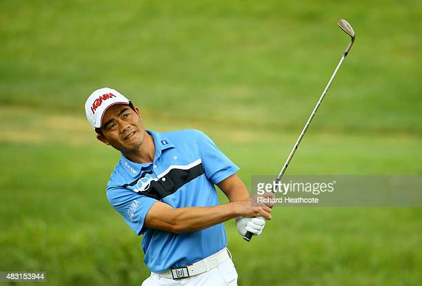 Wenchong Liang of China plays a shot on the first hole during the first round of the World Golf Championships Bridgestone Invitational at Firestone...