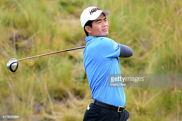 WenChong Liang of China watches his tee shot on the sixth hole during the first round of the 115th US Open Championship at Chambers Bay on June 18...