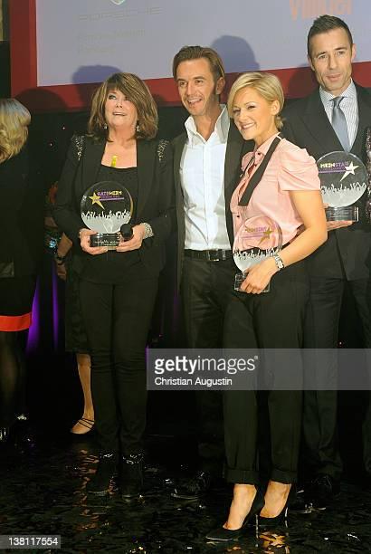 Wencke Myhre Florian Silbereisen and Helene Fischer attend 'Mein Star des Jahres' Awards at Stage Entertainment Theatre on February 2 2012 in Hamburg...