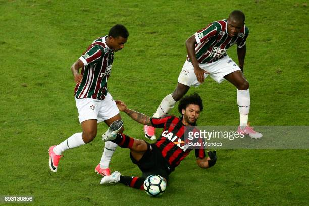Wendel and Luiz Fernando of Fluminense struggle for the ball with Otavio of Atletico PR during a match between Fluminense and Atletico PR as part of...