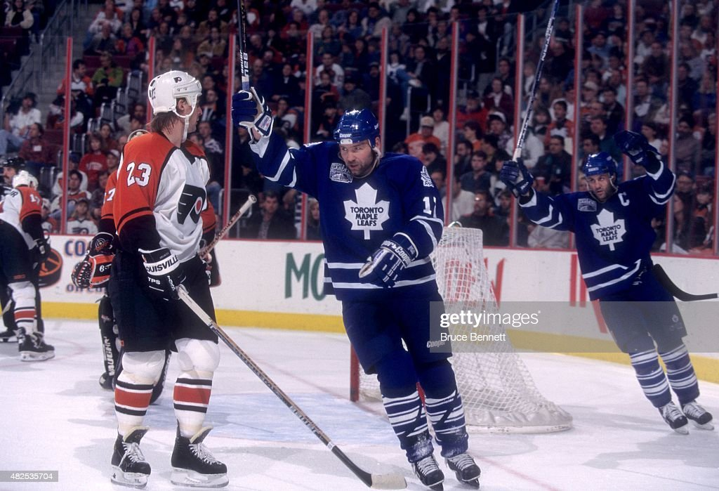 <a gi-track='captionPersonalityLinkClicked' href=/galleries/search?phrase=Wendel+Clark&family=editorial&specificpeople=882632 ng-click='$event.stopPropagation()'>Wendel Clark</a> #17 and <a gi-track='captionPersonalityLinkClicked' href=/galleries/search?phrase=Doug+Gilmour&family=editorial&specificpeople=210813 ng-click='$event.stopPropagation()'>Doug Gilmour</a> #93 of the Toronto Maple Leafs raise their arms while celebrating a goal as Petr Svoboda #23 of the Philadelphia Flyers is dejected on November 30, 1996 at the Wells Fargo Arena in Philadelphia, Pennsylvania.