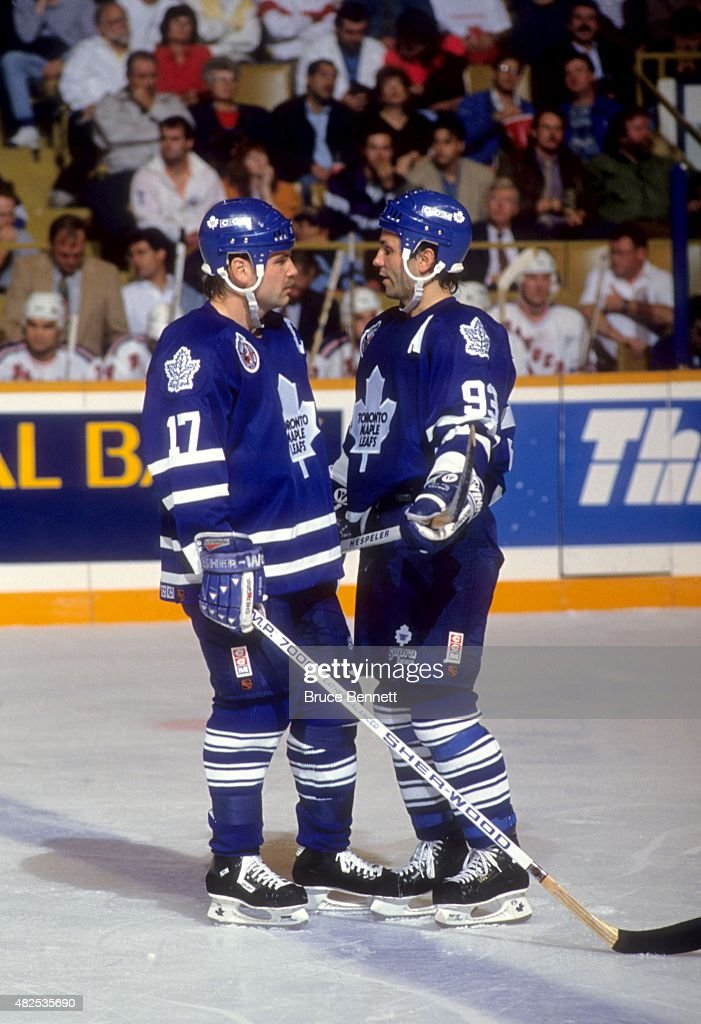 <a gi-track='captionPersonalityLinkClicked' href=/galleries/search?phrase=Wendel+Clark&family=editorial&specificpeople=882632 ng-click='$event.stopPropagation()'>Wendel Clark</a> #17 and <a gi-track='captionPersonalityLinkClicked' href=/galleries/search?phrase=Doug+Gilmour&family=editorial&specificpeople=210813 ng-click='$event.stopPropagation()'>Doug Gilmour</a> #93 of the Toronto Maple Leafs talk on the ice during an NHL game against the New York Rangers on January 30, 1993 at the Maple Leaf Gardens in Toronto, Ontario, Canada.