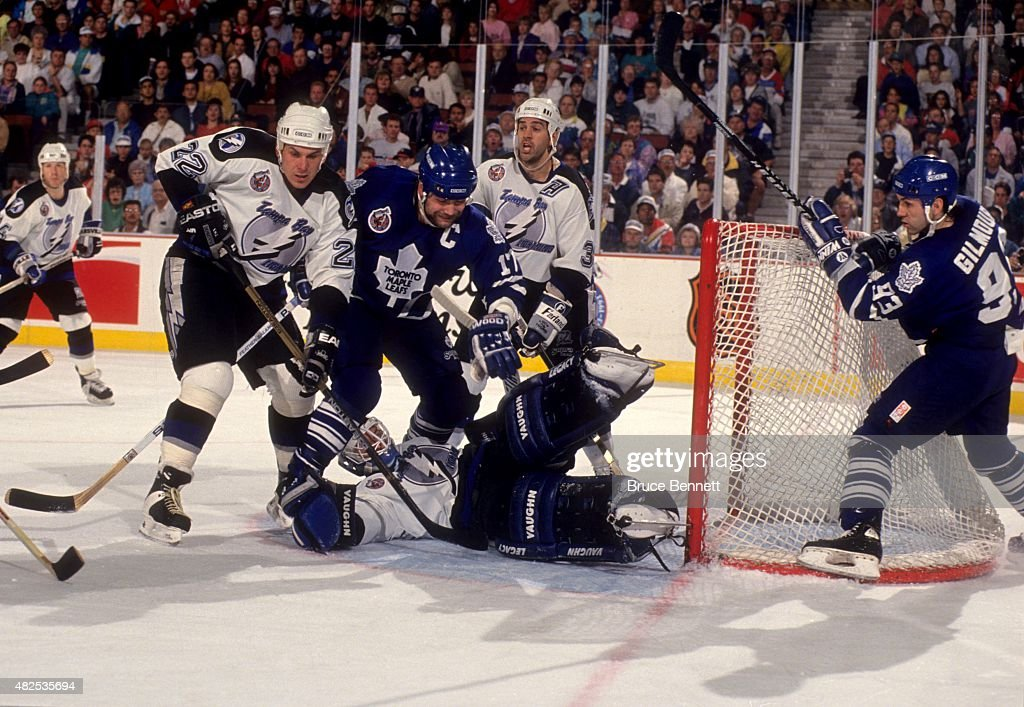 <a gi-track='captionPersonalityLinkClicked' href=/galleries/search?phrase=Wendel+Clark&family=editorial&specificpeople=882632 ng-click='$event.stopPropagation()'>Wendel Clark</a> #17 and <a gi-track='captionPersonalityLinkClicked' href=/galleries/search?phrase=Doug+Gilmour&family=editorial&specificpeople=210813 ng-click='$event.stopPropagation()'>Doug Gilmour</a> #93 of the Toronto Maple Leafs try to score as Shawn Chambers #22, goalie Pat Jablonski #35 and Peter Taglianetti #32 of the Tampa Bay Lightning defend the net on March 18, 1993 at the Expo Hall in Tampa, Florida.