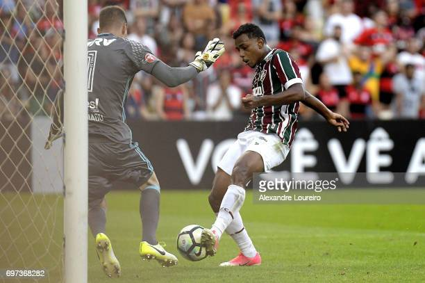 Wendel of Fluminense kicks the scores a goal against Thiago of Flamengo during the match between Fluminense and Flamengo as part of Brasileirao...