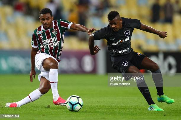 Wendel of Fluminense struggles for the ball with Marcos Vinicius of Botafogo during a match between Fluminense and Botafogo as part of Brasileirao...