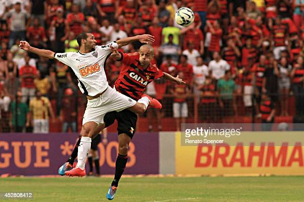 Wendel of Sport Recife battles for the ball with Pierre of Atletico MG during the Brasileirao Series A 2014 match between Sport Recife and Atletico...