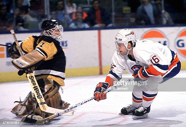 Wendel Young of the Pittsburgh Penguins looks to make a save on Pat Lafontaine of the New York Islanders on January 1 1980 the the Nassau Coliseum in...