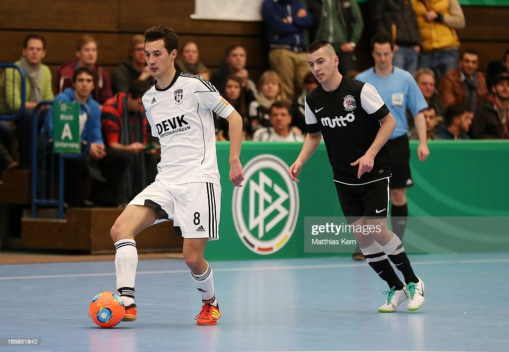 Wendelin Kemper (L) of Muenster battles for the ball with Carlos Rafael Ferreira Monteiro (R) of Hamburg during the DFB Futsal Cup final match between Hamburg Panthers and UFC Muenster at Sporthalle Wandsbek on April 6, 2013 in Hamburg, Germany.