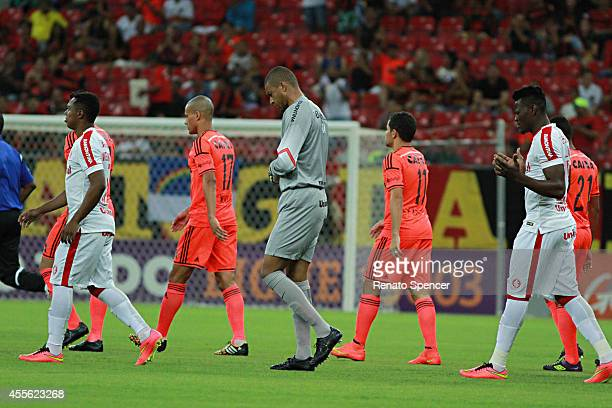 Wendell and Felipe Azevedo of Sport Recife and Dida goalkeeper of Internacional enter into the field before a match between Sport Recife and...