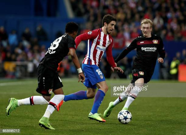 Wendell and Julian Brandt of Bayer 04 Leverkusen in action against Sime Vrsaljko of Atletico Madrid during the UEFA Champions League Round of 16...