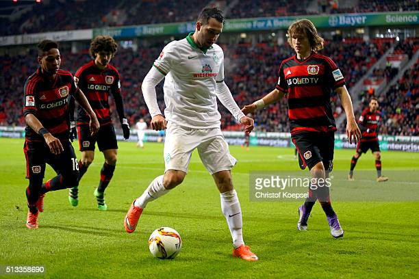 Wendell Andre Ramalho and Tin Jedvaj of Leverkusen challenge Levin Oeztunali of Bremen during the Bundesliga match between Bayer Leverkusen and...