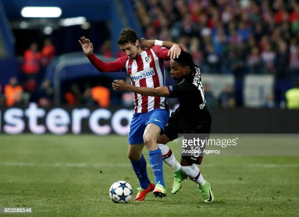 Wendell of Bayer 04 Leverkusen in action against Sime Vrsaljko of Atletico Madrid during the UEFA Champions League Round of 16 football match between...