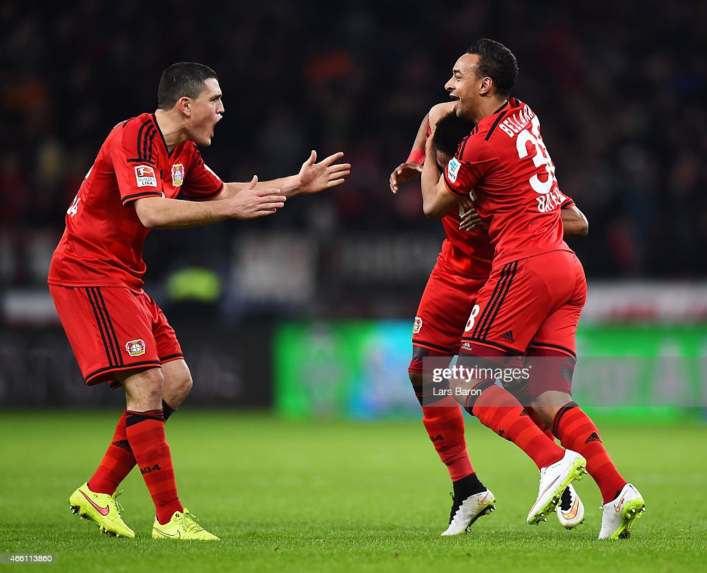 Wendell of Bayer 04 Leverkusen is congratulated by <a gi-track='captionPersonalityLinkClicked' href=/galleries/search?phrase=Kyriakos+Papadopoulos&family=editorial&specificpeople=5446261 ng-click='$event.stopPropagation()'>Kyriakos Papadopoulos</a> and Karim Bellarbi after scoring the first goal during the Bundesliga match between Bayer 04 Leverkusen and VfB Stuttgart at BayArena on March 13, 2015 in Leverkusen, Germany.