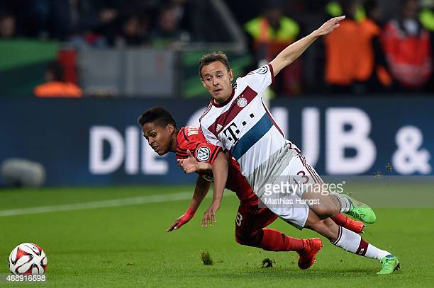 Wendell of Bayer Leverkusen and Rafinha of FC Bayern Muenchen battle for the ball during the DFB Cup Quarter Final match between Bayer Leverkusen and...