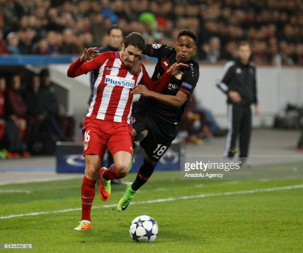 Wendell of Bayer Leverkusen in action against Sime Vrsaljko of Atletico Madrid during the UEFA Champions League round of sixteen soccer match between...