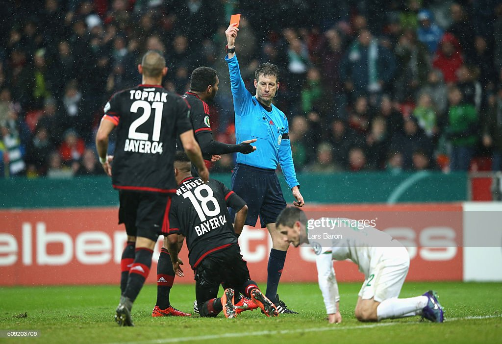 Wendell of Bayer Leverkusen (18) is shown a red card and is sent off by referee <a gi-track='captionPersonalityLinkClicked' href=/galleries/search?phrase=Wolfgang+Stark&family=editorial&specificpeople=587593 ng-click='$event.stopPropagation()'>Wolfgang Stark</a> during the DFB Cup Quarter Final match between Bayer Leverkusen and Werder Bremen at BayArena on February 9, 2016 in Leverkusen, Germany.