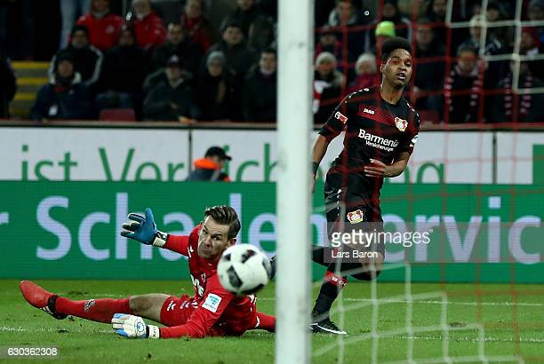 Wendell of Bayer Leverkusen scores his teams first goal against Thomas Kessler of Koeln during the Bundesliga match between 1 FC Koeln and Bayer 04...