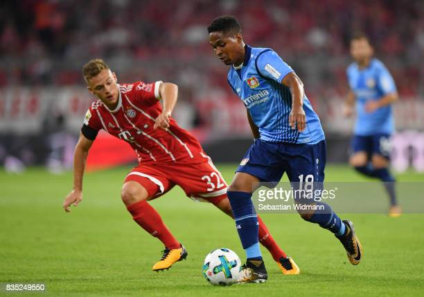 Wendell of Bayer Leverkusen with Joshua Kimmich of Bayern Muenchen during the Bundesliga match between FC Bayern Muenchen and Bayer 04 Leverkusen at...