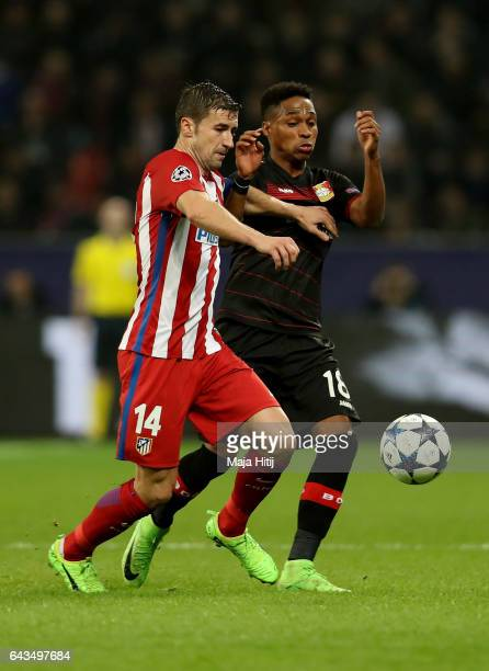 Wendell of Leverkusen and Gabi of Atletico battle for the ball during the UEFA Champions League Round of 16 first leg match between Bayer Leverkusen...