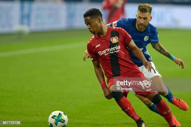 Wendell of Leverkusen and Guido Burgstaller of Schalke battle for the ball during the Bundesliga match between FC Schalke 04 and Bayer 04 Leverkusen...