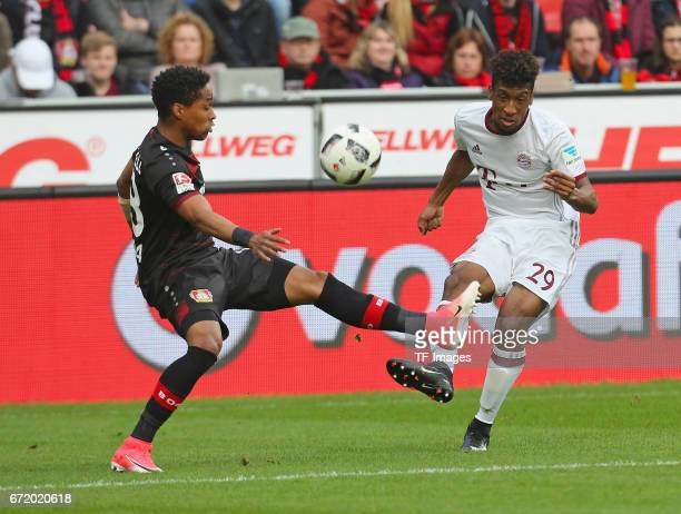Wendell of Leverkusen and Kingsley Coman of Munich battle for the ball during the Bundesliga match between Bayer 04 Leverkusen and Bayern Muenchen at...