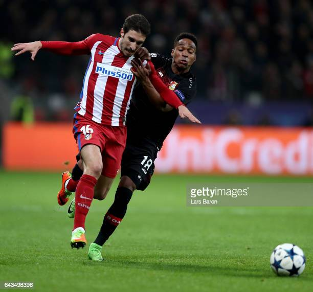 Wendell of Leverkusen and Sime Vrsaljko of Atletico battle for the ball during the UEFA Champions League Round of 16 first leg match between Bayer...