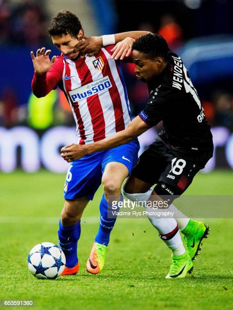 Wendell of Leverkusen and Sime Vrsaljko of Atletico battle for the ball during the UEFA Champions League Round of 16 second leg match between...