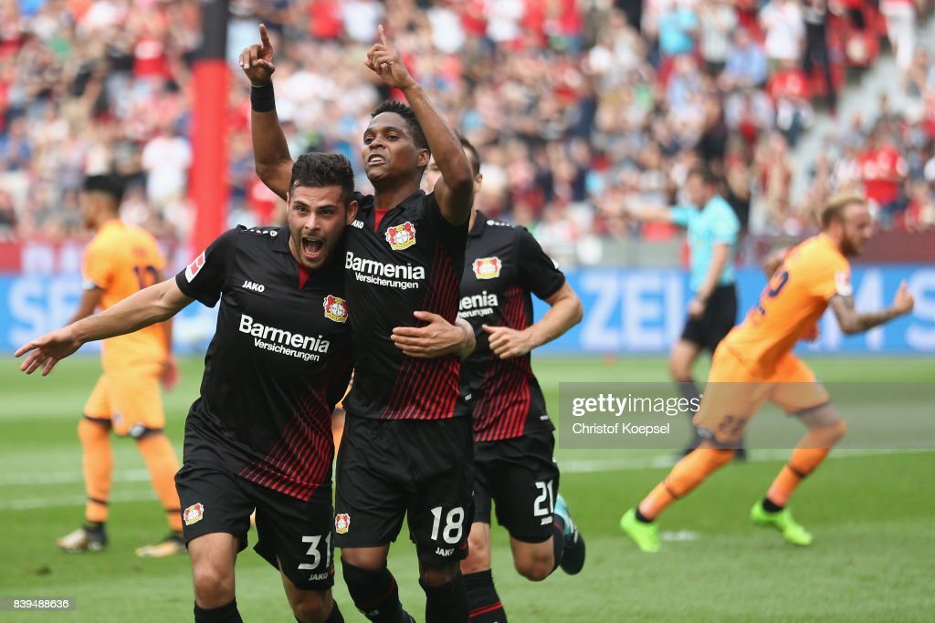 Wendell of Leverkusen (R) celebrates the first goal with Kevin Volland of Leverkusen (L) during the Bundesliga match between Bayer 04 Leverkusen and TSG 1899 Hoffenheim at BayArena on August 26, 2017 in Leverkusen, Germany.
