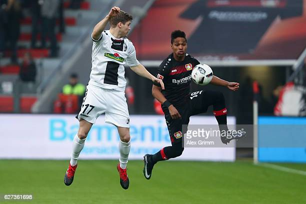 Wendell of Leverkusen is challenged by Lukas Kuebler of Freiburg during the Bundesliga match between Bayer 04 Leverkusen and SC Freiburg at BayArena...