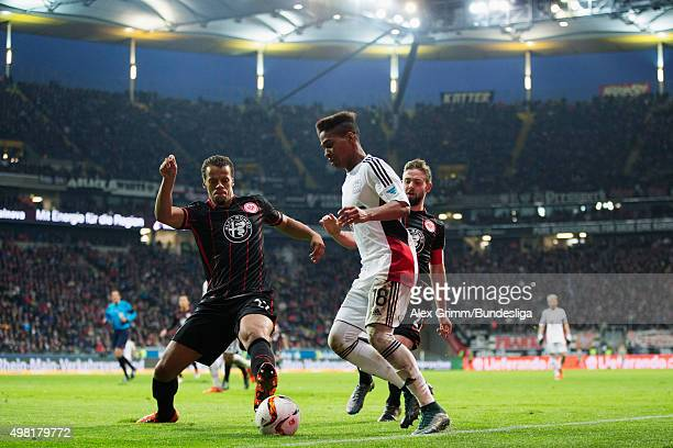 Wendell of Leverkusen is challenged by Timothy Chandler and Marc Stendera of Frankfurt during the Bundesliga match between Eintracht Frankfurt and...