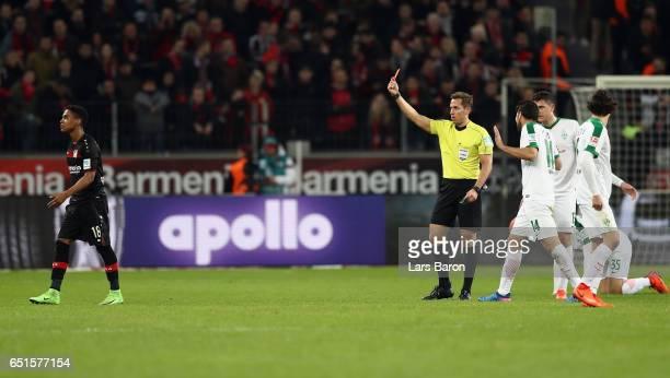 Wendell of Leverkusen is sent off by referee Tobias Stieler during the Bundesliga match between Bayer 04 Leverkusen and Werder Bremen at BayArena on...