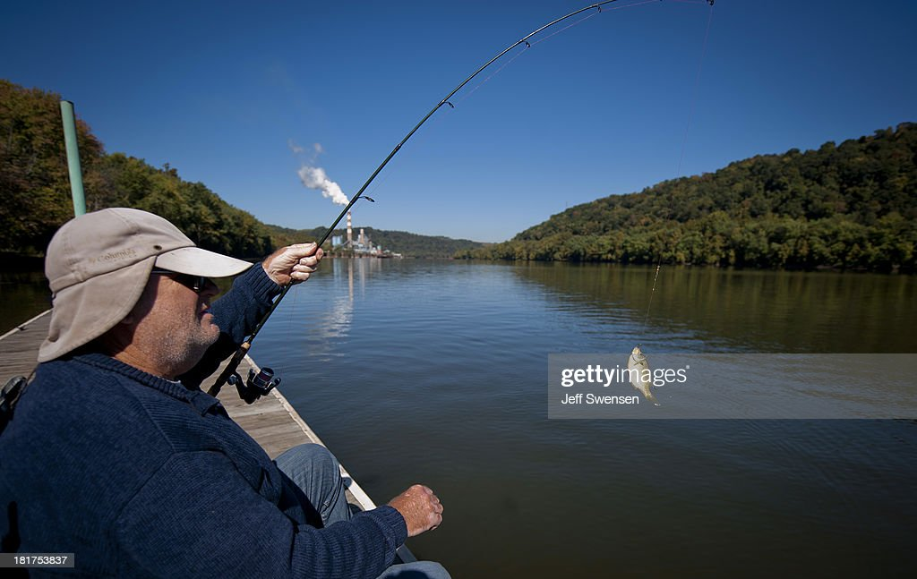 Wendell Patz, 64, fishes upriver from the Mitchell Power Station, a coal-fired power plant built along the Monongahela River, 20 miles southwest of Pittsburgh. The plant, owned by FirstEnergy, will be 1 of 2 plants in the region to be shut down effecting 380 employees. The Evironmental Protection Agency and the Obama Administration have been taking major steps to get coal-fired power plants into compliance with clean air regulations.