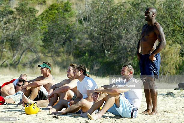 Wendell Sailor Chris Latham Jermey Paul Elton Flatley and Matt Rogers of Australia relax on the beach during a rafting and surfing session held at...