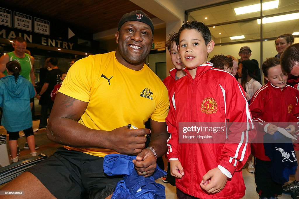 <a gi-track='captionPersonalityLinkClicked' href=/galleries/search?phrase=Wendell+Sailor&family=editorial&specificpeople=204436 ng-click='$event.stopPropagation()'>Wendell Sailor</a> of Australia poses with a child from Khandallah Schol at the start of the ANZA Challenge on October 15, 2013 in Wellington, New Zealand.