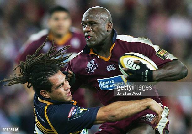 Wendell Sailor of the Reds is tackled by George Smith of the Brumbies during the Super 12 match between the Queensland Reds and ACT Brumbies at...
