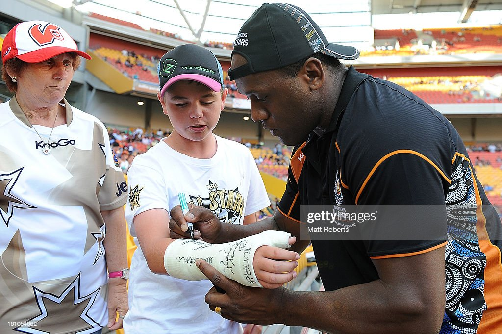 Wendell Sailor signs autographs for fans before the NRL All Stars Game between the Indigenous All Stars and the NRL All Stars at Suncorp Stadium on February 9, 2013 in Brisbane, Australia.