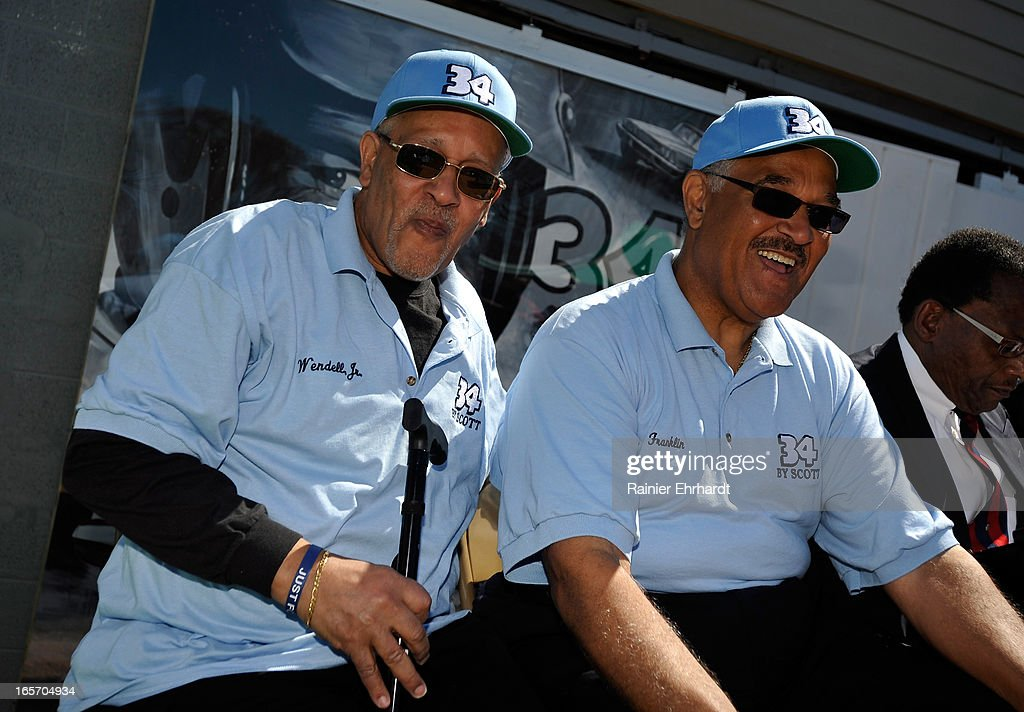 Wendell Scott Jr. (L) and brother Franklin Scott share a laugh during a ceremony for the unveiling of a historical marker in honor of their father, Wendell O. Scott Sr., on April 5, 2013 in Danville, Virginia.