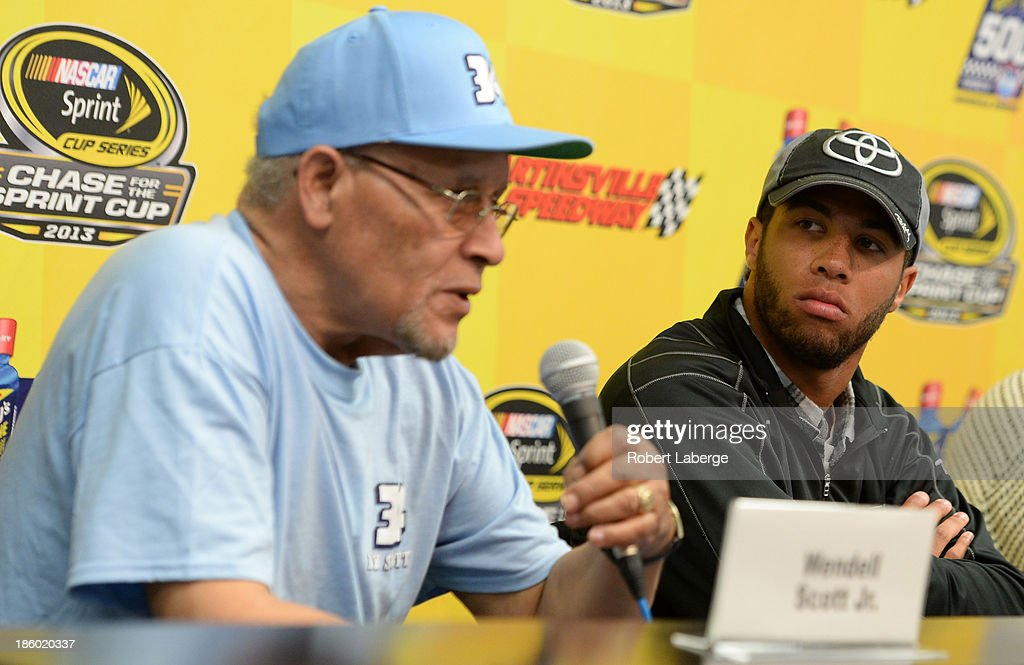 Wendell Scott Jr.(L), son of Wendell Scott, and Darrell Wallace Jr., driver of the #54 ToyotaCare Toyota, speak during a press conference prior to the NASCAR Sprint Cup Goody's Headache Relief Shot 500 Powered By Kroger at Martinsville Speedway on October 27, 2013 in Martinsville, Virginia.