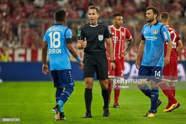 Wendell speak with Tobias Stieler during the Bundesliga match between FC Bayern Muenchen and Bayer 04 Leverkusen at Allianz Arena on August 18 2017...