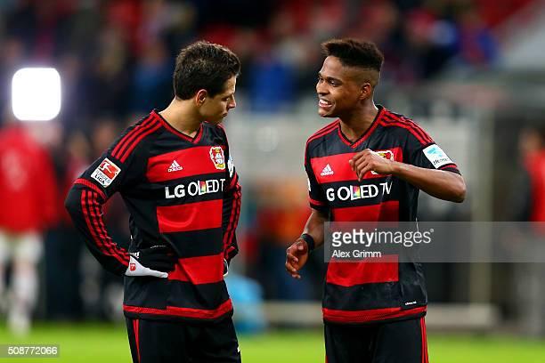 Wendell speaks with teammate Javier Hernandez of Bayer Leverkusen during the Bundesliga match between Bayer Leverkusen and FC Bayern Muenchen at...