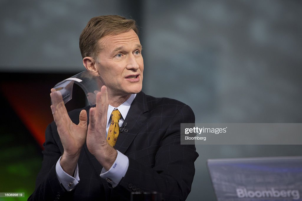Wendell Weeks, chief executive officer of Corning Inc., holds a new piece of glass so thin it can bend, during an interview in New York, U.S., on Thursday, Feb. 7, 2013. Photographer: Scott Eells/Bloomberg via Getty Images