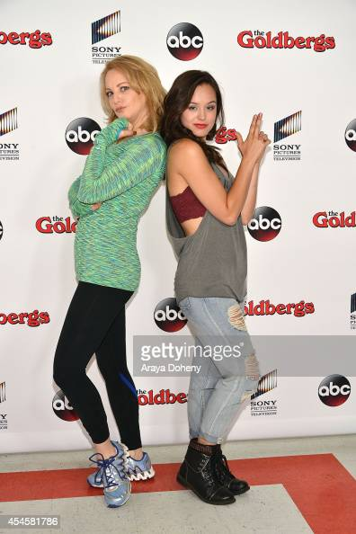 Wendi McLendonCovey and Hayley Orrantia attend 'The Goldbergs' press event held at Moonlight Rollerway on September 3 2014 in Glendale California