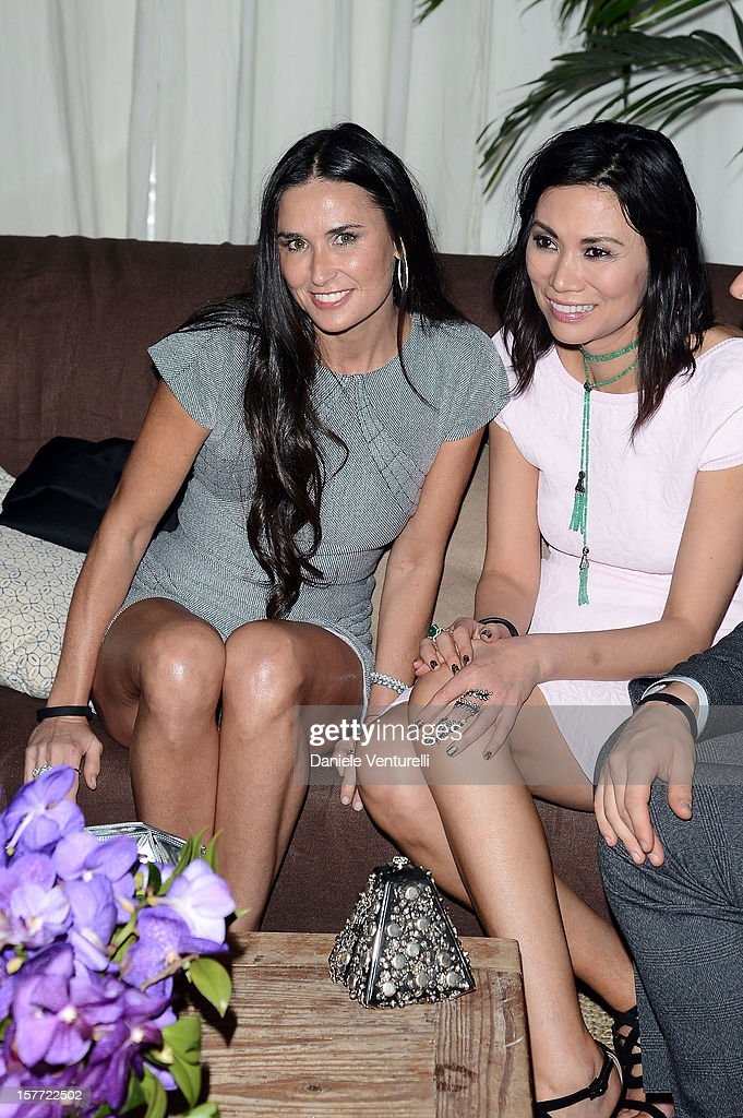 Wendi Murdoch and Demi Moore attend Chanel beachside BBQ celebrating Art.sy at Soho Beach House on December 5, 2012 in Miami Beach, Florida.