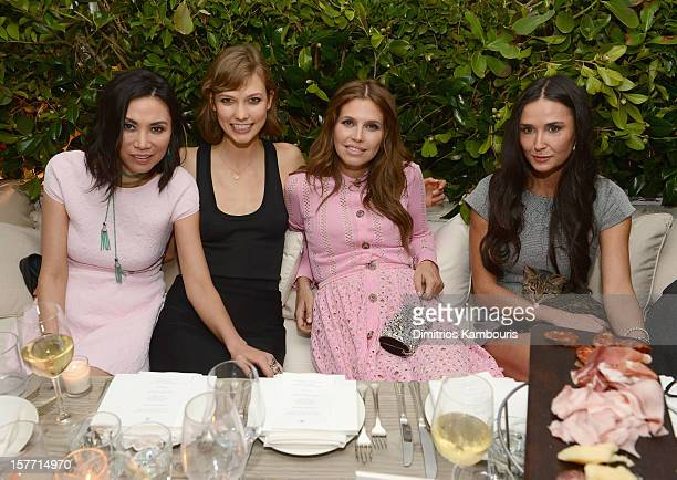 Wendi Murdoch model Karlie Kloss Dasha Zhukova and actress Demi Moore attend a dinner and auction hosted by CHANEL to benefit the Henry Street...