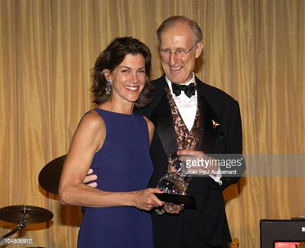 Wendie Malick accepting her 'Emmy for Animals' Award from James Cromwell