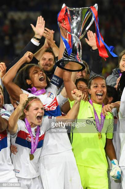 Wendie Renard and Sarah Bouhaddi of Olympique Lyonnais lift the trophy in victory after the UEFA Women's Champions League Final between Lyon and...