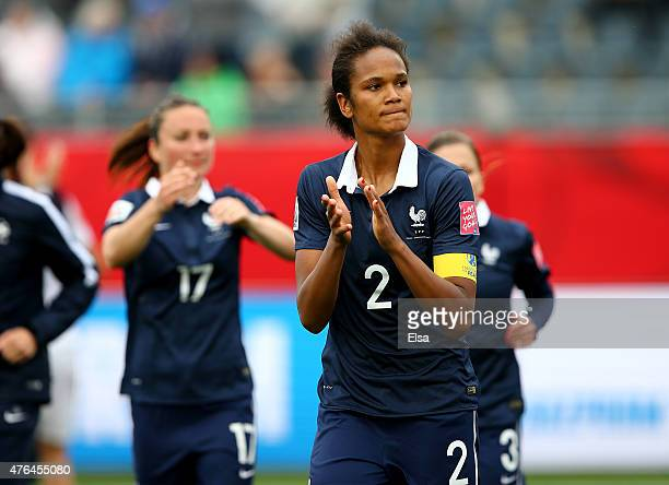 Wendie Renard of France and the rest of her teammates salute the fans after the match against England during the FIFA Women's World Cup 2015 Group F...