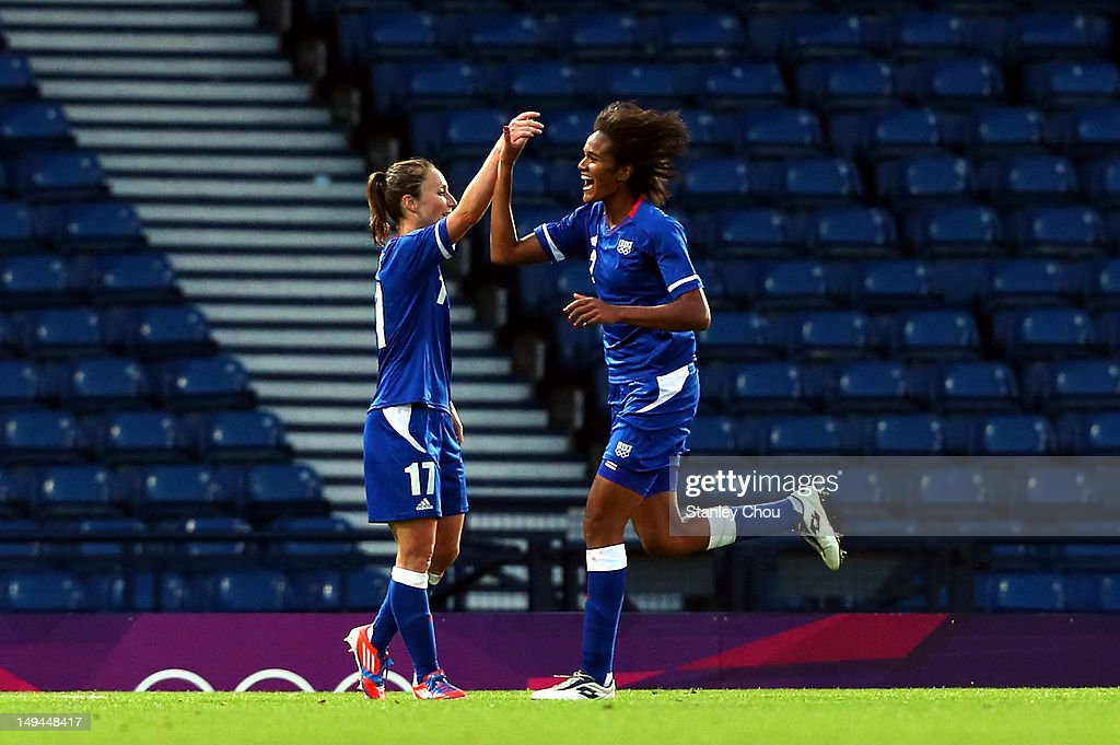 <a gi-track='captionPersonalityLinkClicked' href=/galleries/search?phrase=Wendie+Renard&family=editorial&specificpeople=5780578 ng-click='$event.stopPropagation()'>Wendie Renard</a> of France celebrates with her team-mate <a gi-track='captionPersonalityLinkClicked' href=/galleries/search?phrase=Gaetane+Thiney&family=editorial&specificpeople=2387550 ng-click='$event.stopPropagation()'>Gaetane Thiney</a> after scoring during the Women's Football first round Group G match between France and DPR Korea on Day 1 of the London 2012 Olympic Games at Hampden Park on July 28, 2012 in Glasgow, Scotland.